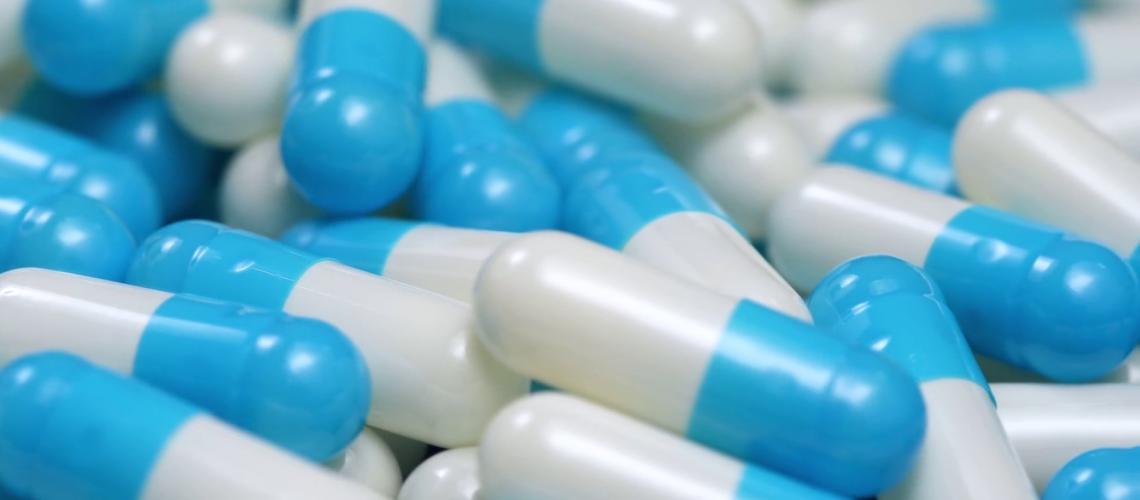 videoblocks-4k-blue-and-white-pills-capsules-camera-pan_b9mamtum1b_thumbnail-full11